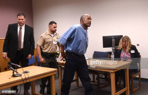 J Simpson passes in front of Warden Renee Baker right during his parole hearing at Lovelock Correctional Center July 20 2017 in Lovelock Nevada...