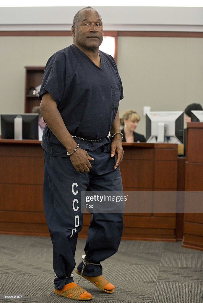 <a gi-track='captionPersonalityLinkClicked' href=/galleries/search?phrase=O.J.+Simpson&family=editorial&specificpeople=123848 ng-click='$event.stopPropagation()'>O.J. Simpson</a> returns to the witness stand to testify after a break in an evidentiary hearing in Clark County District Court May 15, 2013 in Las Vegas, Nevada. Simpson, who is currently serving a nine to 33-year sentence in state prison as a result of his October 2008 conviction for armed robbery and kidnapping charges, is using a writ of habeas corpus to seek a new trial, claiming he had such bad representation that his conviction should be reversed.