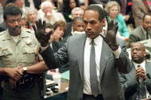J Simpson shows the jury a new pair of Aris extralarge gloves similar to the gloves found at the Bundy and Rockingham crime scene 21 June 1995 during...
