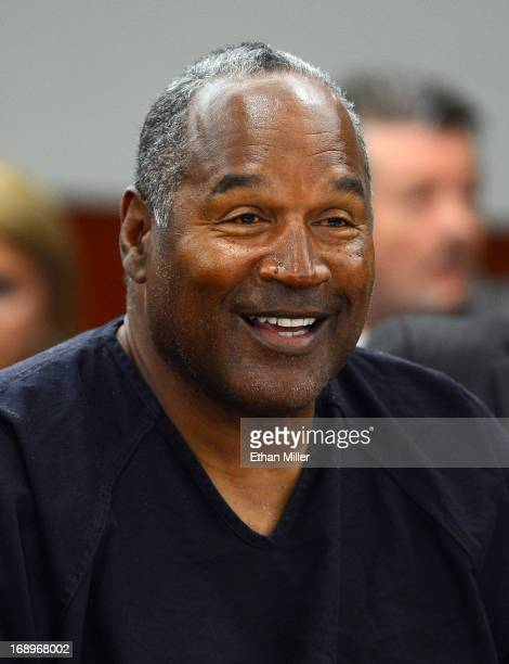 J Simpson smiles during an evidentiary hearing in Clark County District Court on May 17 2013 in Las Vegas Nevada Simpson who is currently serving a...