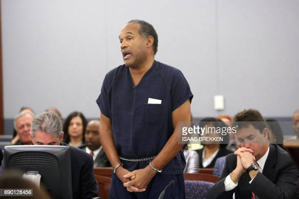 OJ Simpson speaks in court prior to his sentencing as his attorneys Gabriel Grasso and Yale Galanter listen at the Clark County Regional Justice...