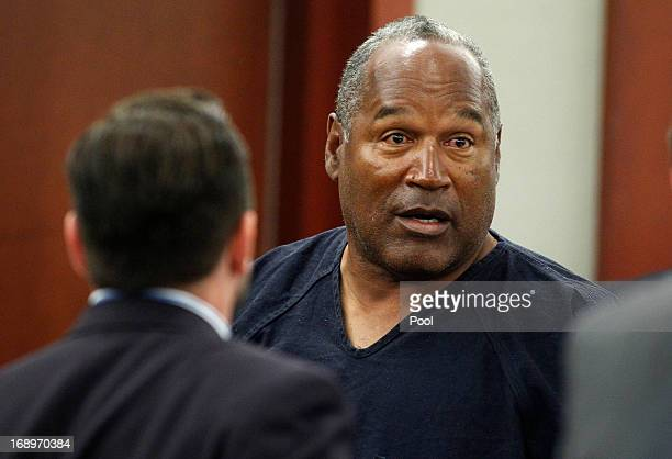 J Simpson stands at the end of an evidentiary hearing in Clark County District Court on May 17 2013 in Las Vegas Nevada Simpson who is currently...