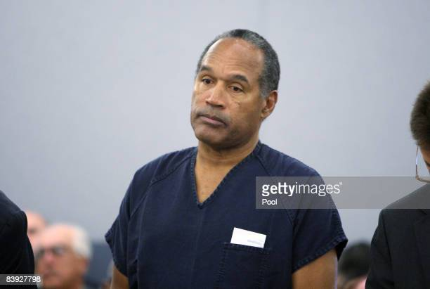 J Simpson stands during sentencing at the Clark County Regional Justice Center December 5 2008 in Las Vegas Nevada Simpson and codefendant Clarence...