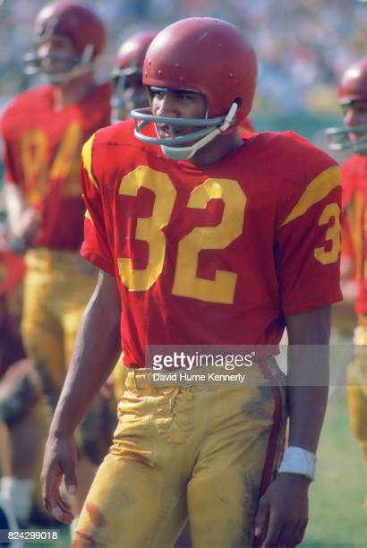 OJ Simpson stands on the side lines during a University of Southern California football game Los Angeles California November 9 1968