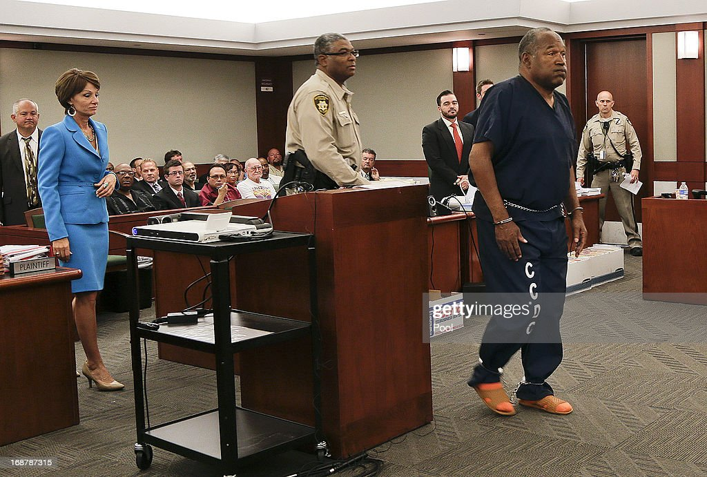 <a gi-track='captionPersonalityLinkClicked' href=/galleries/search?phrase=O.J.+Simpson&family=editorial&specificpeople=123848 ng-click='$event.stopPropagation()'>O.J. Simpson</a> (R) walks up to the witness stand to testify during an evidentiary hearing in Clark County District Court May 15, 2013 in Las Vegas, Nevada. Simpson, who is currently serving a nine to 33-year sentence in state prison as a result of his October 2008 conviction for armed robbery and kidnapping charges, is using a writ of habeas corpus to seek a new trial, claiming he had such bad representation that his conviction should be reversed.