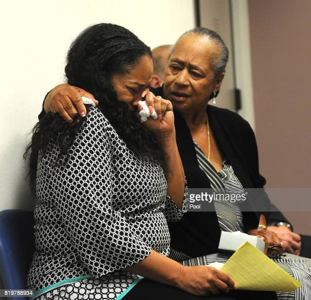 J Simpson's sister Shirley Baker right daughter Arnelle Simpson react during Simpson's parole hearing at Lovelock Correctional Center July 20 2017 in...