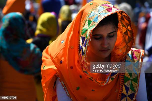 Simrat Kaur marches with other Sikhs during the second annual American Sikh day parade march by on May 28 2017 in Denver Colorado The Sikhs hold the...