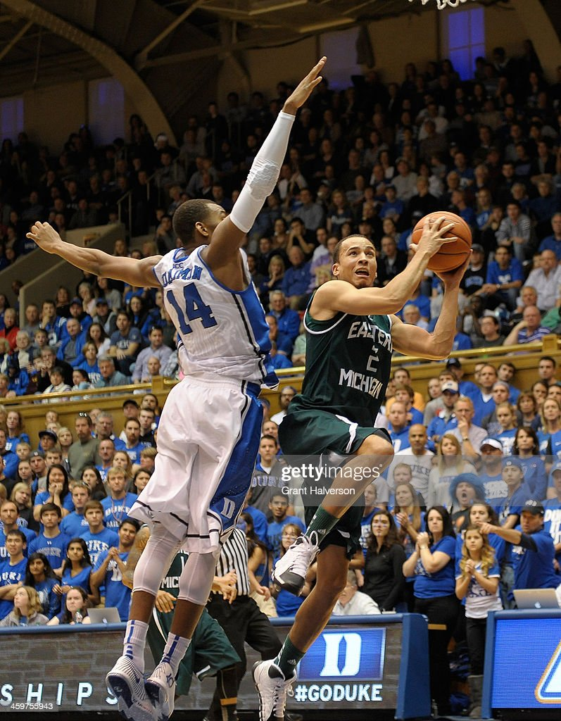 J.R. Sims #2 of the Eastern Michigan Eagles drives against <a gi-track='captionPersonalityLinkClicked' href=/galleries/search?phrase=Rasheed+Sulaimon&family=editorial&specificpeople=7887134 ng-click='$event.stopPropagation()'>Rasheed Sulaimon</a> #14 of the Duke Blue Devils during their game at Cameron Indoor Stadium on December 28, 2013 in Durham, North Carolina. Duke won 82-59.