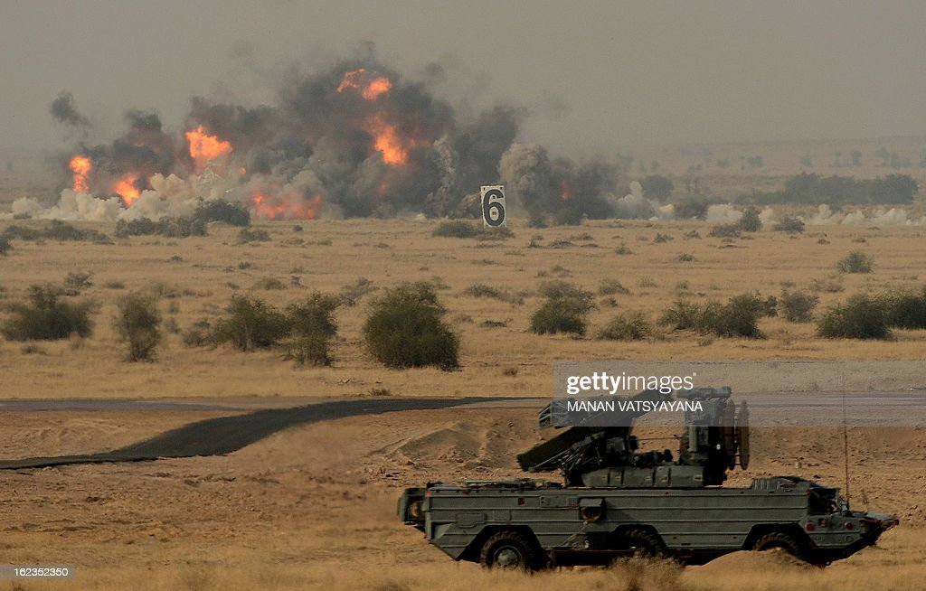 A simulated target is destroyed by Indian Air Force (IAF) Jaguar Aircraft during the Iron Fist 2013 exercise in Pokhran on February 22, 2013. IAF held the Iron Fist 2013 exrecise to showcase its operational capabilities during day,dusk and night taking out simulated targets with precison laser-guided weaponry. AFP PHOTO/ MANAN VATSYAYANA