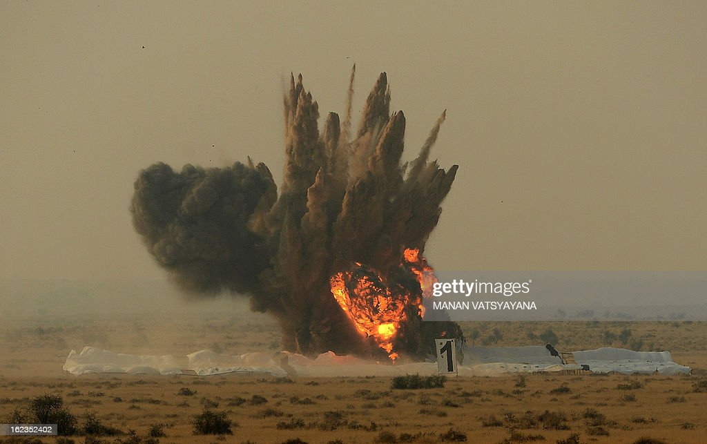 A simulated target is destroyed by Indian Air Force (IAF) Sukhoi-30 aircraft during the Iron Fist 2013 exercise in Pokhran on February 22, 2013. IAF held the Iron Fist 2013 exrecise to showcase its operational capabilities during day,dusk and night taking out simulated targets with precison laser-guided weaponry. AFP PHOTO/ MANAN VATSYAYANA