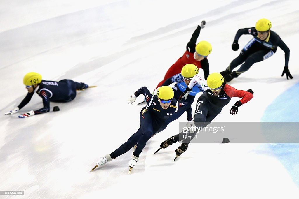 Sin Da Woon of Korea crashes out as Noh Jinkyu of Korea (Front), <a gi-track='captionPersonalityLinkClicked' href=/galleries/search?phrase=Charles+Hamelin&family=editorial&specificpeople=820316 ng-click='$event.stopPropagation()'>Charles Hamelin</a> of Canada (Right), Yuzo Takamido of Japan (Top), Victor An of Russia (Center) and Han Tianyu of China rush to the finish line in the Men's 1500m Final during day three of the Samsung ISU World Cup Short Track at the Oriental Sports Center on September 28, 2013 in Shanghai, China.