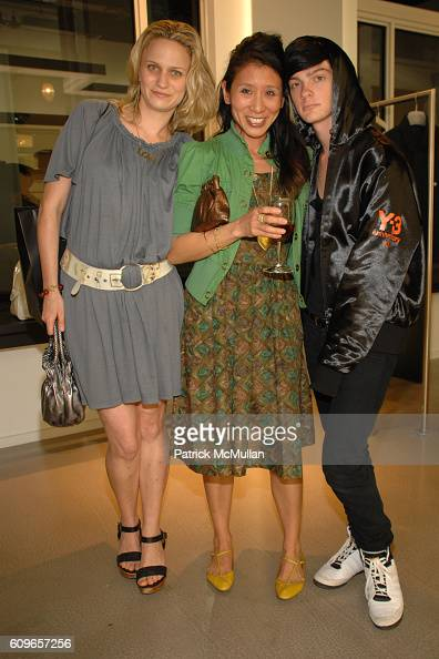 Sina Schloss Tina Tang and Joshua August attend Y3 EAI Party for ART IN MOTION at Y3 Miami on December 8 2007 in Miami Florida