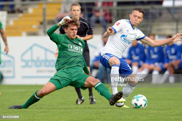 Sinan Ayguen of Guetersloh and Fabian Reese of Schalke battle for the ball during the preseason friendly match between FC Gütersloh and FC Schalke 04...
