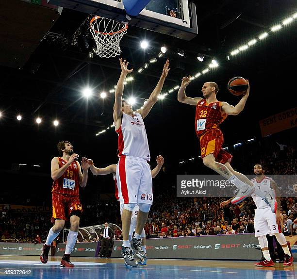 Sinan Guler #32 of Galatasaray Liv Hospital Istanbul competes with Boban Marjanovic #13 of Crvena Zvezda Telekom Belgrade during the 20142015 Turkish...