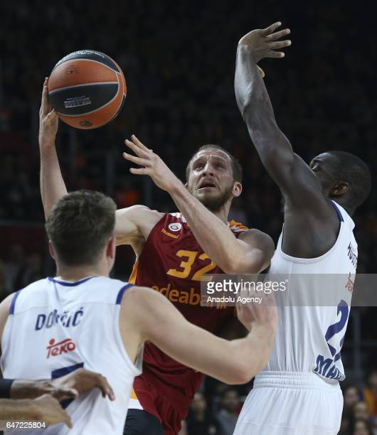 Sinan Guler of Galatasaray Odeabank in action against Luka Doncic during the Turkish Airlines Euroleague match between Galatasaray Odeabank and Real...