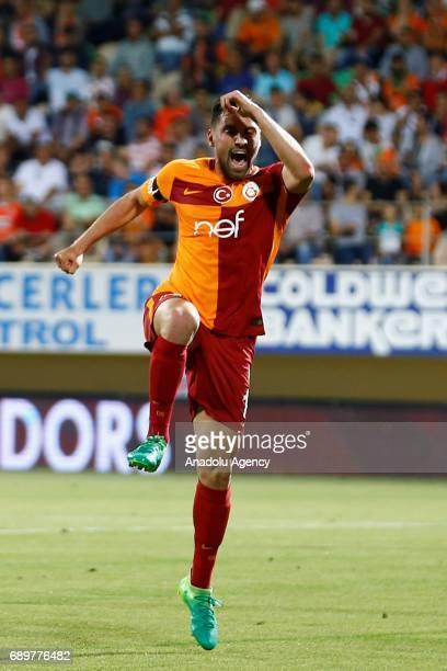 Sinan Gumus of Galatasaray celebrates after scoring during the Turkish Spor Toto Super Lig match between Aytemiz Alanyaspor and Galatasaray at...