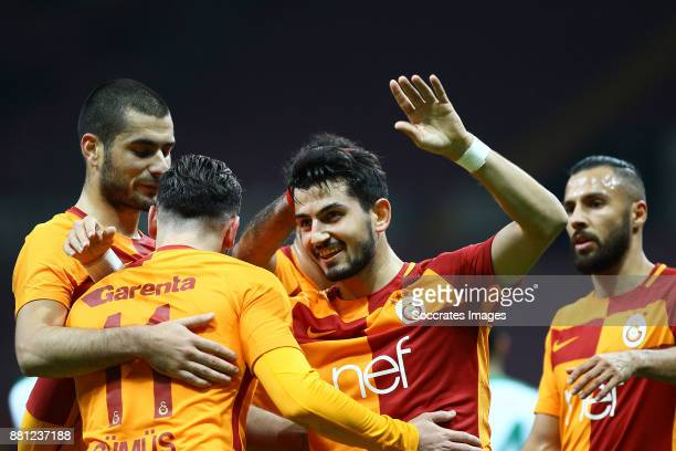 Sinan Gumus of Galatasaray celebrates with Emrah Bassan of Galatasaray Eren Derdiyok of Galatasaray during the Turkish Cup match between Galatasaray...