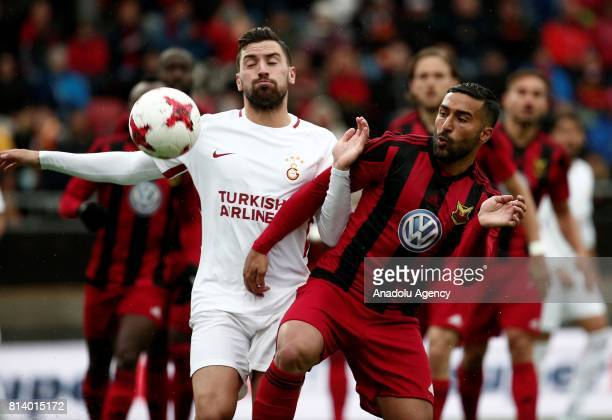 Sinan Gumus of Galatasaray in action against Saman Ghoddos of Ostersund during the UEFA Europa League 2nd Qualifying Round soccer match between...