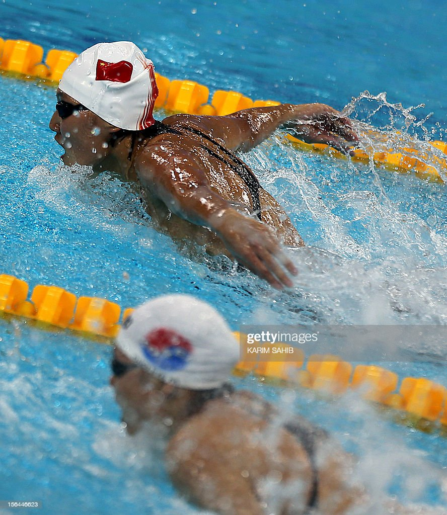 Sinan Ha of China (TOP) competes in the Women's 200m butterfly final during the 9th Asian Swimming Championships in Dubai, on November 15, 2012.