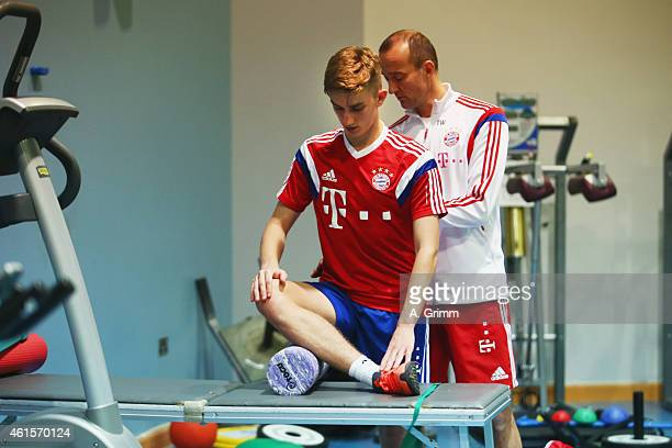Sinan Kurt exercises in the gym with fitness coach Thomas Wilhelmi during day 7 of the Bayern Muenchen training camp at ASPIRE Academy for Sports...
