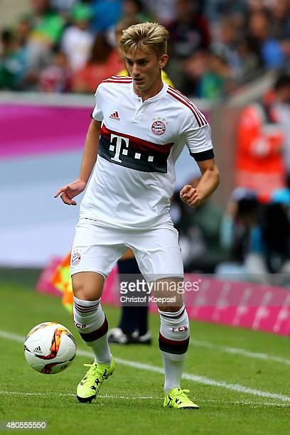 Sinan Kurt of Bayern runs with the ball during the Telekom Cup 2015 Semi Final match between Borussia Moenchegladbach and Hamburger SV at...