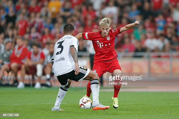 Sinan Kurt of FC Bayern Muenchen challenges with Ruben Nunes Vezo of Valencia FC during the international friendly match between FC Bayern Muenchen...