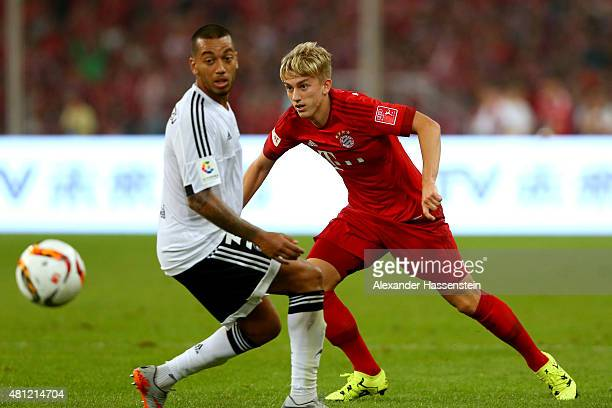 Sinan Kurt of Muenchen battles for the ball with Ruben Nunes Vezo of Valencia during the international friendly match between FC Bayern Muenchen and...