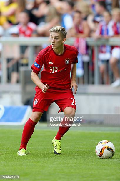 Sinan Kurt runs with the ball during a FC Bayern Muenchen training session after the FC Bayern Muenchen season opening and team presentation at...
