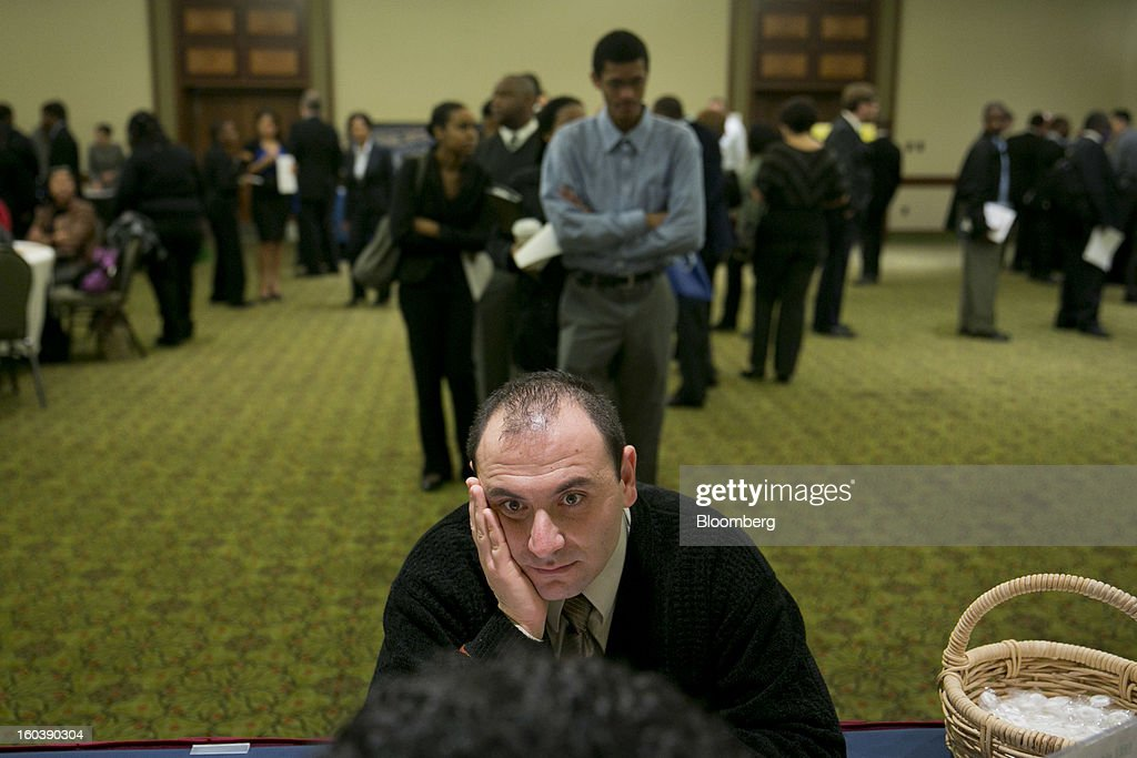 Sinan Sulaiman speaks to a resume professional at a National Career Fairs job fair in Arlington, Virginia, U.S., on Wednesday, Jan. 30, 2013. The U.S. Labor Department is scheduled to release initial jobless claims data on Jan. 31. Photographer: Andrew Harrer/Bloomberg via Getty Images