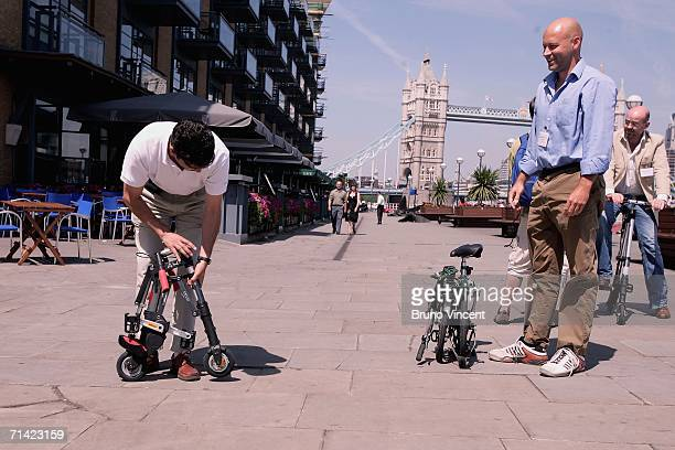Sinclair Chief Designer Alex Kalogroulis has a race with a journalist to fold up the new 'ABike' versus a Brompton folding bicycle on July 12 2006 in...