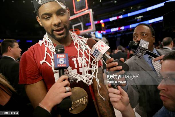 Sindarius Thornwell of the South Carolina Gamecocks celebrate with the the trophy after defeating the Florida Gators with a score of 77 to 70 to win...