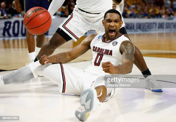 Sindarius Thornwell of the South Carolina Gamecocks celebrates in the second half against the Marquette Golden Eagles during the first round of the...