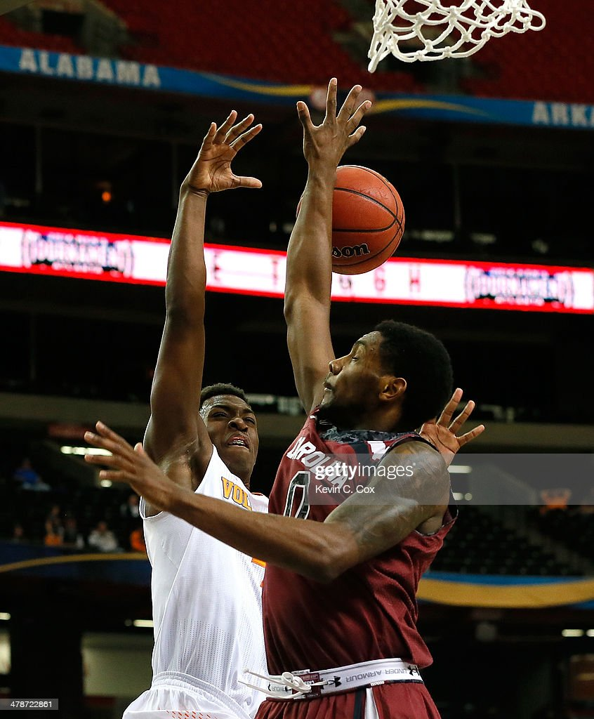 Sindarius Thornwell #0 of the South Carolina Gamecocks defends against Armani Moore #4 of the Tennessee Volunteers during the quarterfinals of the SEC Men's Basketball Tournament at Georgia Dome on March 14, 2014 in Atlanta, Georgia.