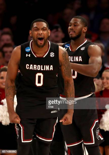 Sindarius Thornwell of the South Carolina Gamecocks reacts with his teammate Justin McKie in the second half against the Baylor Bears during the 2017...