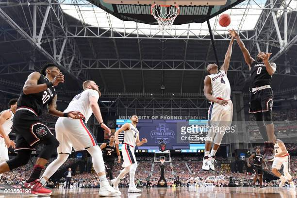 Sindarius Thornwell of the South Carolina Gamecocks takes a jumpshot over Jordan Mathews of the Gonzaga Bulldogs during the 2017 NCAA Men's Final...