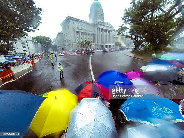 Singapore 29 March 2015 Funeral procession for Singapore's founding Prime Minister Lee Kwan Yew taking place in heavy tropical rain in front of the...