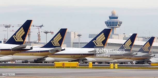 Singapore Airlines Ltd planes sit parked at Changi Airport in Singapore on Thursday Oct 25 2007 Singapore Airlines Ltd Asia's most profitable carrier...