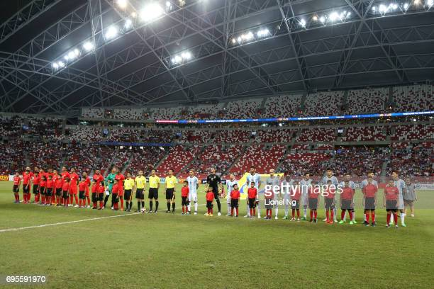 Singapore and Argentina line up for the national anthems of their respective countries before the international friendly match between Argentina and...