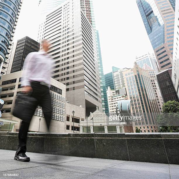 Singapore businessman walking through the Central Business District.