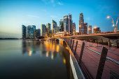 Singapore skyline at night. Singapore central business district skyline, blue sky and night skyline from marina bay. Singapore cityscape. Marina bay, tourist destination and city center of Singapore.