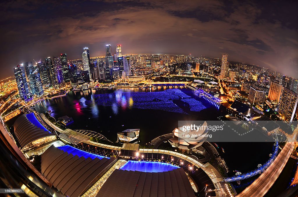 CONTENT] Singapore cityscape as seen from the Skypark viewing deck , Marina Bay Sands. The blue balls floating on Marina bay are the Wishing Spheres where wishes are written and will remain floating on the the Bay for the New Year Countdown celebrations.