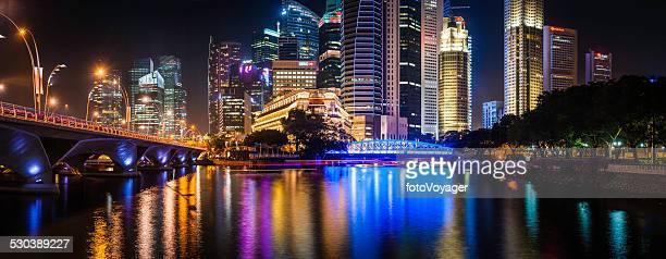 Singapore glittering skyscrapers illuminated neon night futuristic crowded cityscape panorama