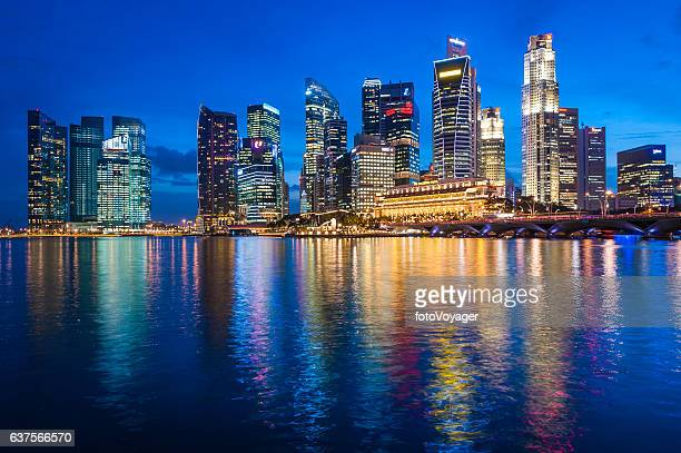 Singapore illuminated neon skyscrapers of Downtown Core overlooking Marina Bay