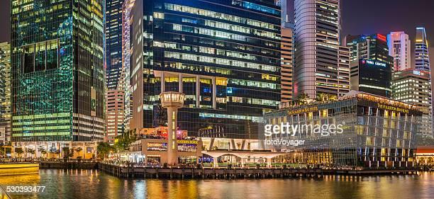 Singapore Marina Bay glittering skyscrapers bars restaurants illuminated at dusk