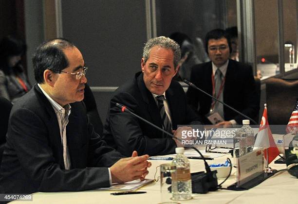 Singapore Minister of Trade and Industry Lim Hng Kiang speaks as US trade representative Michael Froman listens during the TransPacific Partnership...
