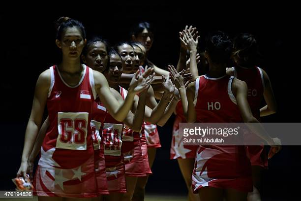 Singapore players line up at court during the women's netball gold medal match between Singapore and Malaysia at the OCBC Arena Hall during the 2015...