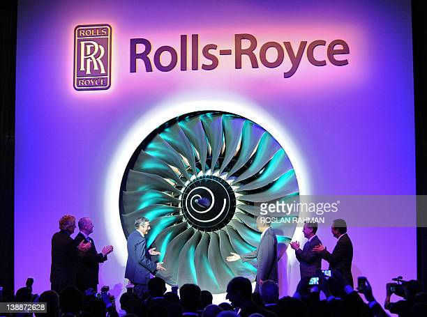 Singapore Prime Minister Lee Hsien Loong and Simon Robertson chairman of RollsRoyce officiate the opening of a RollsRoyce manufacturing and training...