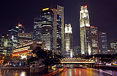 Singapore, Raffles City, illuminated hotel and office buildings, dusk