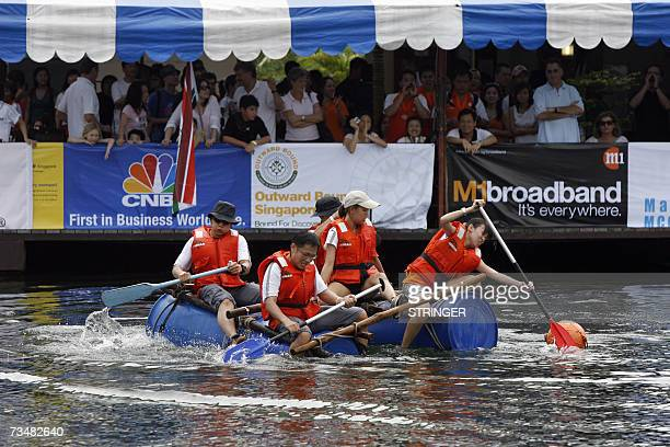 Participants race on a raft in a lake in Pulau Ubin off Singapore 03 February 2007 The participants are competing in the Asia's corporate team...