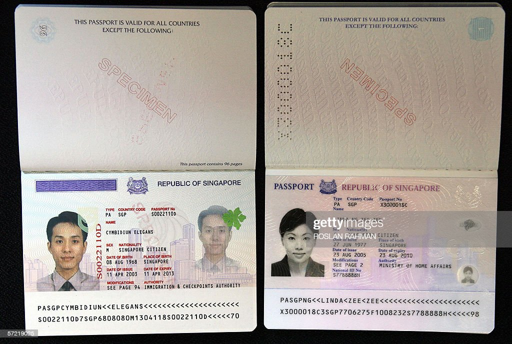 This photo shows the bio-data page of a Singapore passport (L) and the ...